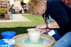 Georgia Mountain Parkway - Pottery artist demonstrating her craft at Arts in the Park Festival in Blue Ridge, Georgia