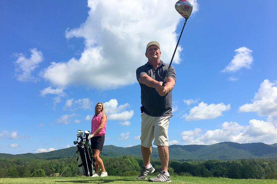 Georgia Mountain Parkway - Couple enjoys a day of golfing at the scenic Butternut Creek Golf Course in Blairsville, Georgia