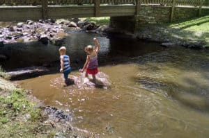 Georgia Mountain Parkway - Children play in the creek at Blairsville, Georgia's, popular Meeks Park